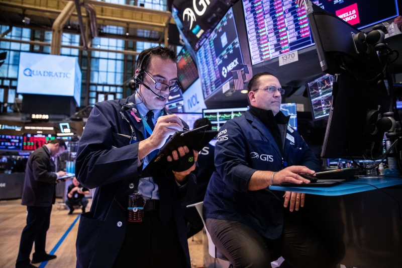 NEW YORK, NY - MARCH 12: Traders work on the floor of the New York Stock Exchange (NYSE) on March 12, 2020 in New York City. The Dow Jones Industrial Average dropped 2,352 points, an almost 10 percent decline and biggest since 1987.   Jeenah Moon/Getty Images/AFP