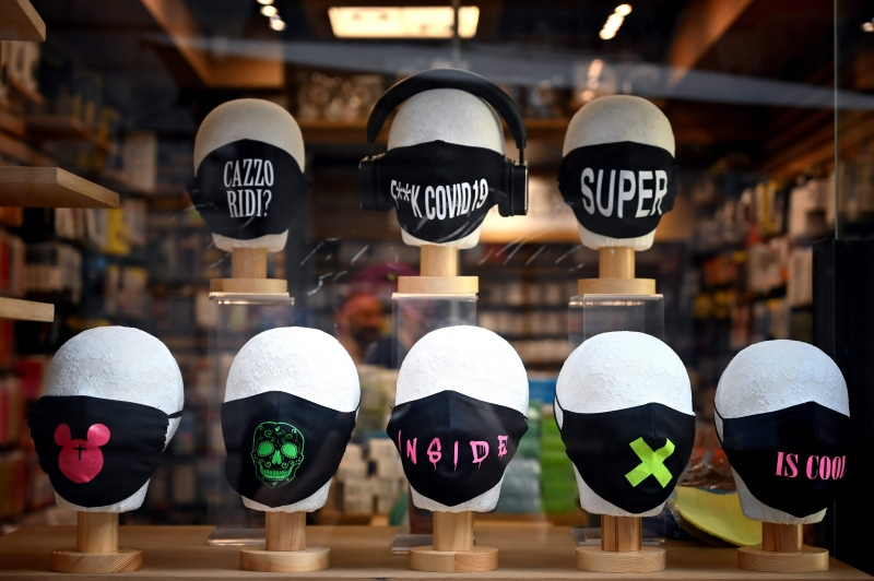 Facial masks for sale are on display in a shop on May 12, 2020 in Rome, as the country is under lockdown to stop the spread of the Covid-19 disease caused by the novel coronavirus. (Photo by Alberto PIZZOLI / AFP)       Caption