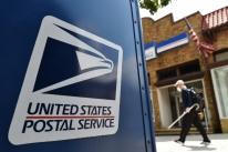 Pressionado, diretor do serviço postal dos EUA adia mudançasque poderiam atrasar envio de votos