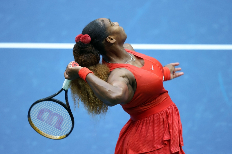 NEW YORK, NEW YORK - SEPTEMBER 01: Serena Williams of the United States serves the ball during her Women's Singles first round match against Kristie Ahn of the United States on Day Two of the 2020 US Open at the USTA Billie Jean King National Tennis Center on September 1, 2020 in the Queens borough of New York City.   Al Bello/Getty Images/AFP