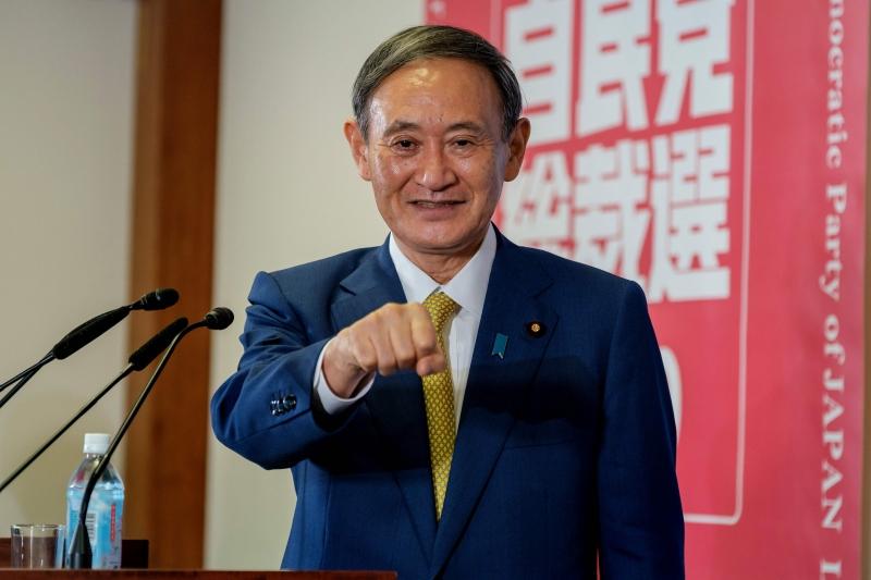 Suga prometeu realizar a Olimpíada como 'uma prova da vitória humana contra o coronavírus'