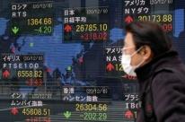 Bolsas da Ásia fecham em queda por cautela com Covid-19, mas Hong Kong sobe