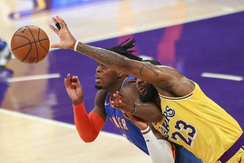 LOS ANGELES, CALIFORNIA - FEBRUARY 10: LeBron James ♯23 of the Los Angeles Lakers loses possession of the ball to Luguentz Dort ♯5 of the Oklahoma City Thunder at Staples Center on February 10, 2021 in Los Angeles, California. NOTE TO USER: User expressly acknowledges and agrees that, by downloading and or using this photograph, User is consenting to the terms and conditions of the Getty Images License Agreement.   Meg Oliphant/Getty Images/AFP       Caption