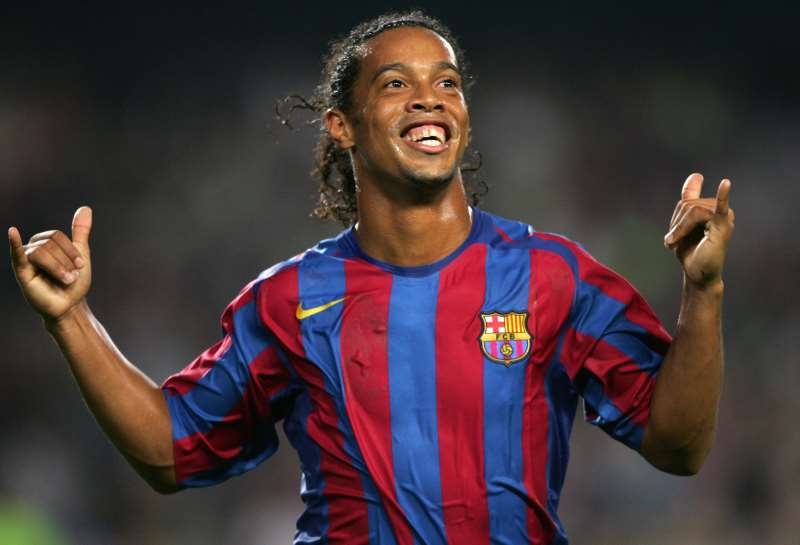 FC BARCELONA'S BRAZILIAN RONALDINHO CELEBRATES THE SECOND GOAL AGAINST REAL SOCIEDAD DURING THEIR SPANISH LEAGUE FOOTBALL MATCH AT THE CAMP NOU STADIUM IN BARCELONA, 30 OCTOBER 2005.  RONALDINHO IS AMONG THE FAVORITES TO WIN THE 2005 EUROPEAN FOOTBALLER OF THE YEAR AWARD, BETTER KNOW AS THE BALLON D'OR (GOLDEN BALL). VOTING FOR THE AWARD IS UNDERTAKEN BY A GROUP OF EUROPEAN FOOTBALL JOURNALISTS AND IS GIVEN TO THE PLAYER CONSIDERED TO HAVE PERFORMED THE BEST IN EUROPE OVER THE PAST 12 MONTHS
