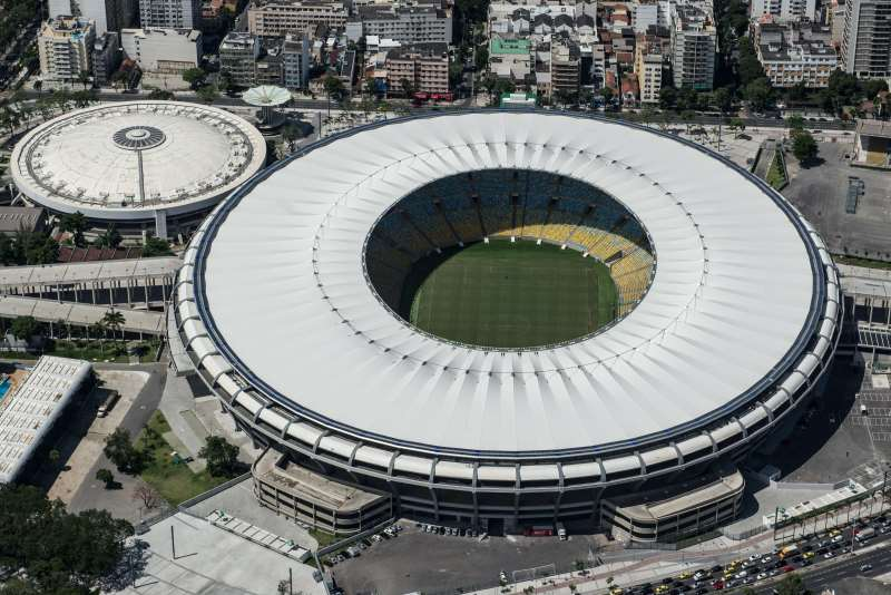 (FILE) AERIAL VIEW OF THE MARIO FILHO (MARACANA) STADIUM IN RIO DE JANEIRO, BRAZIL, ON DECEMBER 3, 2013. THE MARACANA STADIUM WILL HOST THE BRAZIL 2014 FIFA WORLD CUP AND THE 2016 SUMMER OLYMPICS. THE MARACANÃ STADIUM, A FOOTBALLING MECCA WHICH EVERY FAN DREAMS OF VISITING, HAS MORPHED INTO AN ULTRA-MODERN, SUSTAINABLE AND SAFE ARENA, ALBEIT ONE WITH ELITIST TRAITS, COMPARED TO THE POPULIST TEMPLE IT ONCE WAS.  AFP PHOTO / YASUYOSHI CHIBA
