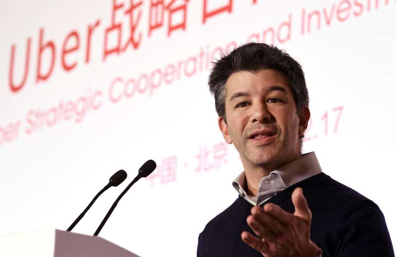TO GO WITH AFP STORY BY ROB LEVER  (FILES) -- THIS FILE PHOTO TAKEN ON DECEMBER 17, 2014 SHOWS UBER CEO TRAVIS KALANICK SPEAKING AT A CEREMONY AT THE BAIDU HEADQUARTERS IN BEIJING. UNLIKE MANY AMERICAN STARTUPS, UBER WAS NOT FOUNDED IN SOMEONE'S GARAGE, BUT WAS CONCEIVED INSTEAD ON A COLD NIGHT IN PARIS, WHEN TWO TECH ENTREPRENEURS COULD NOT FIND A TAXI. UBER CHIEF TRAVIS KALANICK AND CO-FOUNDER GARRETT CAMP WERE ATTENDING THE TECHNOLOGY CONFERENCE LE WEB IN LATE 2008, WHERE THEY WERE BRAINSTORMING IDEAS FOR A NEW VENTURE -- IN KALANICK'S TERMS,