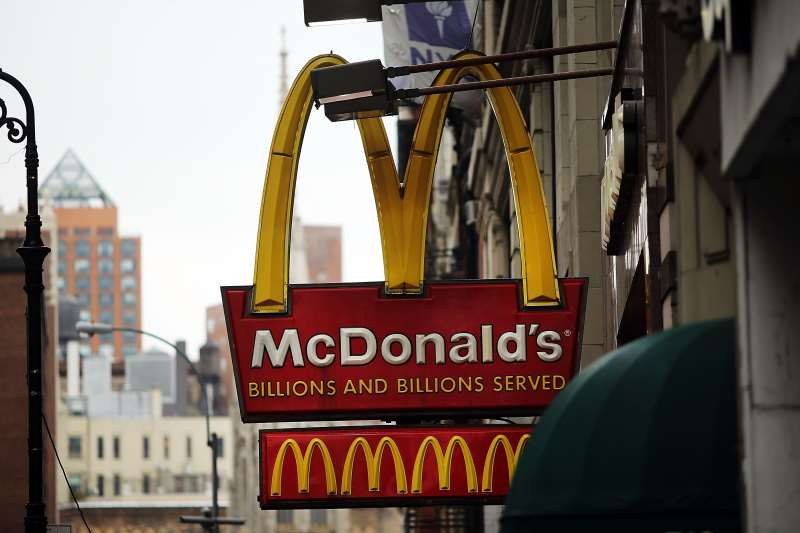 NEW YORK, NY - FEBRUARY 09: A MCDONALD'S SIGN HANGS IN LOWER MANHATTAN ON FEBRUARY 9, 2015 IN NEW YORK CITY. MCDONALD'S CORPORATION HAS SAID SALES IN JANUARY FELL A WORSE-THAN-EXPECTED 1.8%. WHILE THE FAST-FOOD RESTAURANT CHAIN SAID U.S. AND EUROPE SALES SHOWED SIGNS OF IMPROVEMENT, ASIA SALES SLOWED. MCDONALD'S IS FACING NEW COMPLETION FROM TRENDIER AND MORE HEALTH CONSCIOUS FAST FOOD CHAINS LIKE CHIPOTLE MEXICAN GRILL AND SHAKE SHACK.   SPENCER PLATT/GETTY IMAGES/AFP  == FOR NEWSPAPERS, INTERNET, TELCOS & TELEVISION USE ONLY ==