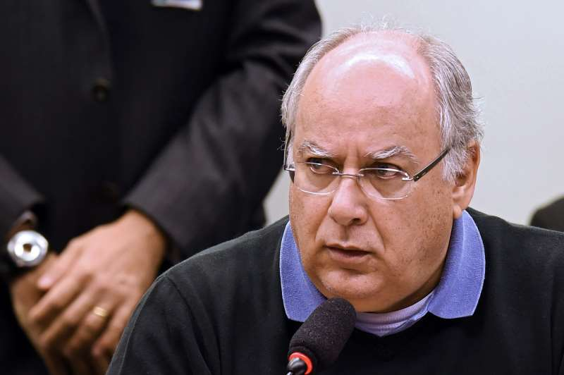 PETROBRAS FORMER SERVICE DIRECTOR RENATO DUQUE PEDRO SPEAKS DURING A HEARING WITH THE PARLIAMENTARY COMMISSION OF INQUIRY IN THE CHAMBER OF DEPUTIES, THAT INVESTIGATES ACCUSATIONS OF CORRUPTION IN PETROBRAS, IN BRASILIA ON MARCH 10, 2015. DOZENS OF POLITICIANS FROM FIVE PARTIES, INCLUDING FROM THAT OF BRAZILIAN PRESIDENT DILMA ROUSSEFF, HAVE BEEN IMPLICATED IN A CORRUPT NETWORK WHICH LAUNDERED $4 BILLION OF BRAZIL'S STATE OIL GIANT MONEY.  AFP PHOTO/EVARISTO SA