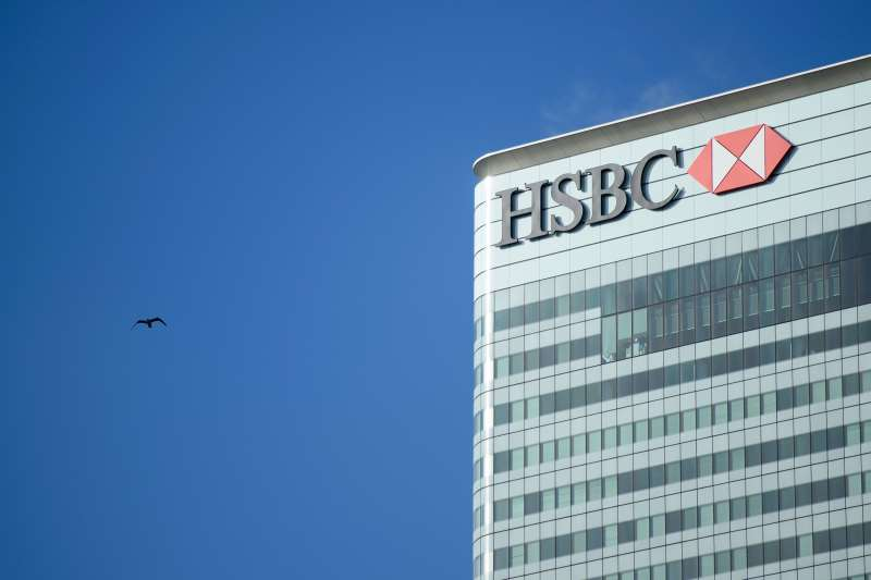 The London offices of HSBC are seen in the Canary Wharf district of London on February 15, 2016. Europe's largest bank HSBC informed the financial markets it would remain headquartered in Britain, rejecting a move to Hong Kong despite concerns about increased regulation in the UK. HSBC has been based in Britain since 1992 when it took over Midland Bank and shifted its headquarters from Hong Kong to London. / AFP / LEON NEAL