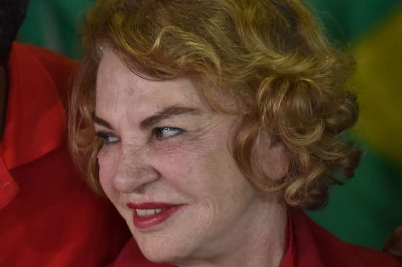 The wife of Brazilian former president Luiz InÁcio Lula da Silva, Marisa Leticia, is pictured at a polling station during the municipal elections' first round at a school in Sao Bernardo do Campo, 25 km south of Sao Paulo, Brazil, on October 2, 2016. Brazilians furious at recession and corruption voted Sunday in municipal elections amid heightened security after a series of murders of candidates. Among the first to cast his ballot in the financial capital Sao Paulo was Brazilian President Michel Temer from the center-left PMDB party, who took over the presidency in August after turning on his former leftist ally Dilma Rousseff and helping to force her from the top job in an impeachment vote